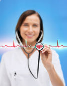 Female doctor with stethoscope — Stock Photo