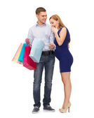 Happy family expecting child with shopping bags — Stock Photo