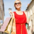 Beautiful woman with shopping bags in the ctiy — Stock Photo #39709653