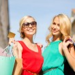 Stock Photo: Beautiful women with shopping bags in the ctiy