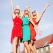 Three beautiful women in the city — Stock Photo