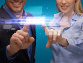 Man and woman hands pointing at virtual screen — Stock Photo