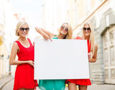 Three happy blonde women with blank white board — Stock Photo