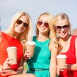 Women with takeaway coffee cups in the city — Stock Photo #39710285