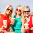 Women with takeaway coffee cups in the city — Stock Photo