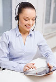 Friendly female helpline operator with tablet pc — Photo