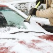 Stock Photo: Closeup of mscraping ice from car