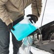 Closeup of man pouring antifreeze into water tank — Stock Photo