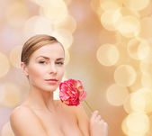Lovely woman with peonie flower — Photo