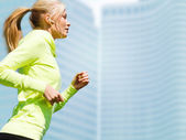Woman doing running outdoors — Stock Photo