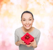 Smiling asian woman with red gift box — Stock Photo