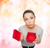 Disappointed asian woman with empty red gift box — Stok fotoğraf