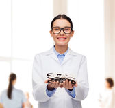 Smiling female doctor with eyeglasses — Stock Photo