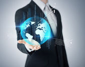 Businessmans hand showing earth globe — Stock Photo