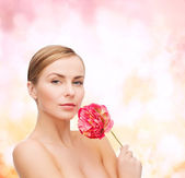 Lovely woman with peonie flower — Stockfoto