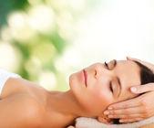Beautiful woman in spa salon having facial — Stock Photo