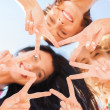 Girls looking down and showing finger five gesture — Stock Photo