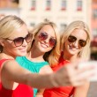 Girls taking picture with smartphone camera — Stock Photo