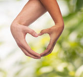 Woman and man hands showing heart shape — Foto de Stock