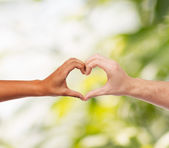 Woman and man hands showing heart shape — Stock Photo