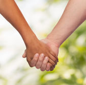 Woman and man holding hands — Stockfoto