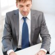 Businessman with laptop computer and documents — Stock Photo