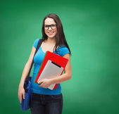 Smiling student with bag, folders and tablet pc — Stok fotoğraf