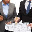Businesspeople with clipboard and blueprint — Stock Photo