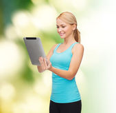 Sporty woman with tablet pc — Stock Photo