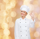 Smiling female chef showing ok hand sign — Foto Stock