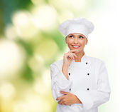 Smiling female chef dreaming — Stock fotografie