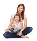 Happy mother with adorable little girl — Stock Photo