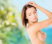 Woman checking breast for signs of cancer — Stockfoto