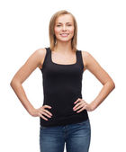 Smiling woman in blank black tank top — Stockfoto