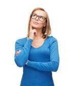 Happy woman in black eyeglasses dreaming — Stock Photo