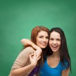 Two laughing girls hugging — Stock Photo #40235693