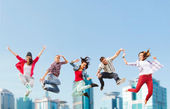 Group of teenagers jumping — 图库照片