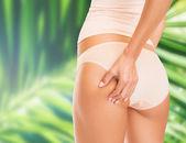 Woman in cotton underwear showing slimming concept — ストック写真
