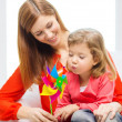 Happy mother and daughter with pinwheel toy — Stock Photo