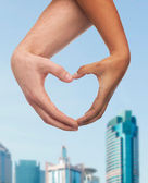 Woman and man hands showing heart shape — Foto Stock