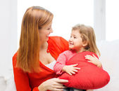 Happy mother and child with big red heart at home — Stock Photo