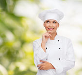 Smiling female chef dreaming — Stock Photo