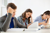 Students with notebooks and tablet pc at school — Stock Photo