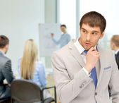 Pensive man at office — Stock Photo