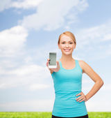 Sportowy kobieta z smartphone — Zdjęcie stockowe