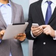 Two businesspeople with smartphone and tablet pc — Stock Photo #40560551