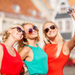 Three beautiful girls taking picture in the city — Stock Photo