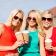 Women with takeaway coffee cups in the city — Stock Photo #40562473