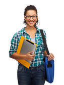 Smiling student with folders, tablet pc and bag — Stock Photo