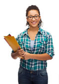 Female black student in eyeglasses with folders — Stock Photo